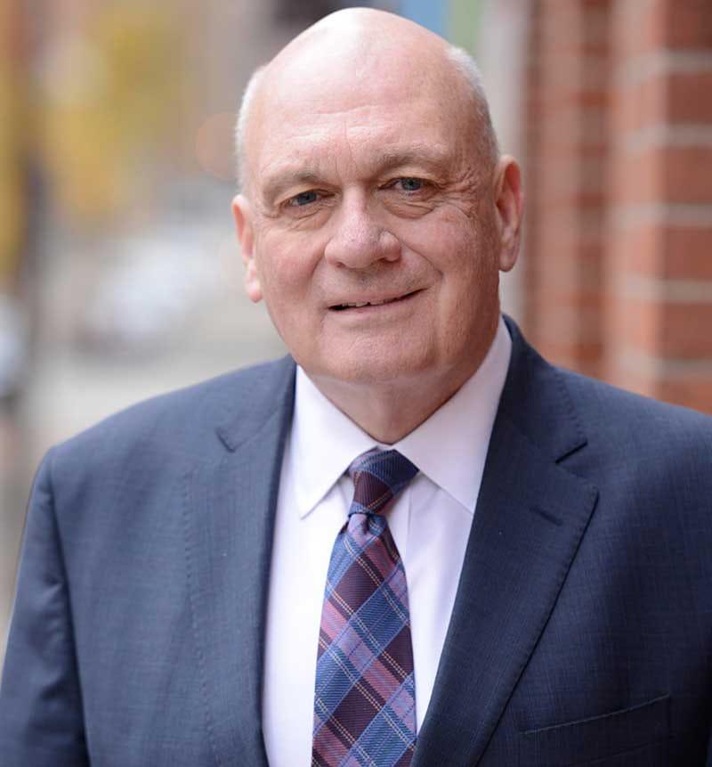 John E. Quinnn Partner