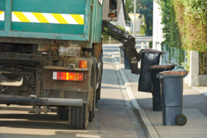 Car and Garbage Truck in Early Morning Collision | Quinn Logue